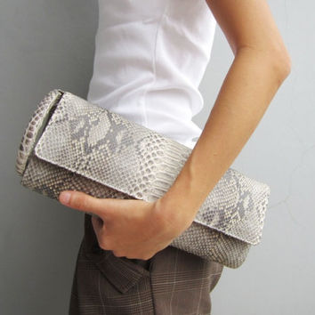 Super cute snakeskin clutch