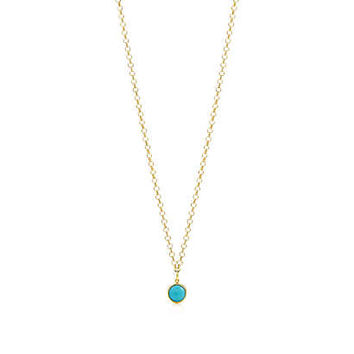 Tiffany & Co. - Paloma Picasso® turquoise dot charm in 18k gold on a round link chain.