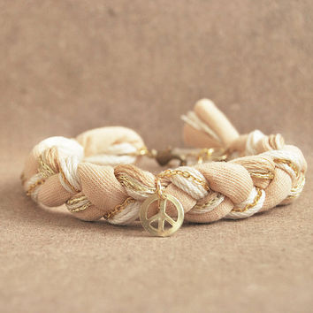 Beige bracelet with peace charm, braided bracelet, hippie bracelet
