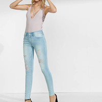 Faded Distressed Mid Rise Jean Leggings from EXPRESS