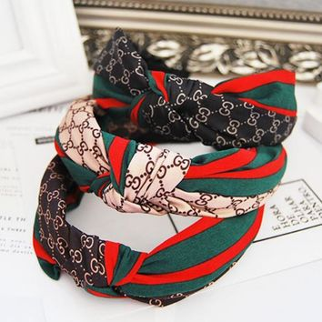 GUCCI red and green striped letters wild Western knot fabric hair card wide hair bands
