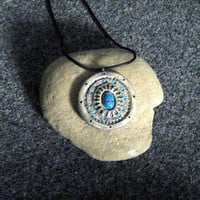 Round Egyptian style pendant with turquoise scarab in the center