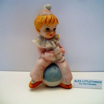vintage girl tumbler clown figurine sitting on ball