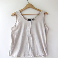 80s beige cropped tank top with buttons down the front.