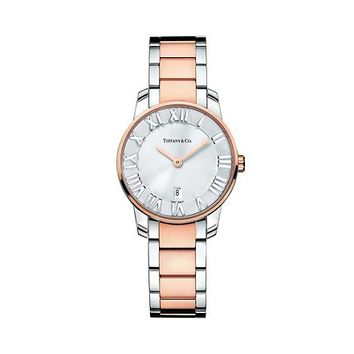 Tiffany & Co. -  Atlas® dome watch in 18k rose gold and stainless steel, quartz movement.