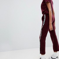 Fila Velour Tracksuit Bottoms With Poppers And Logo Tape at asos.com