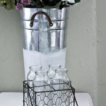 Chicken wire basket with milk bottle glass vases // centerpiece perfect for a farmhouse wedding or cottage home decor