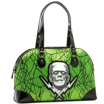 Frankenstein's monster with lightening-bolts embellished on this lovely horror green purse with spiderweb lace details. It features two rolled handles, shinny vinyl bottom with metal feet, and is fully lined.