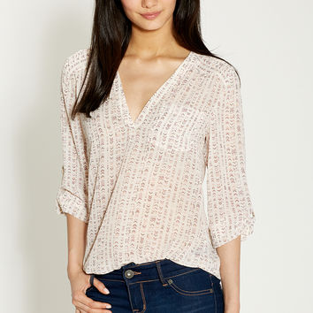 the perfect blouse in arrow print