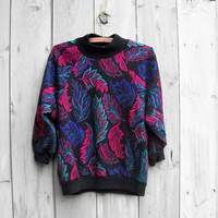 Vintage sweater - Black 1980s sweater with pink, teal and purple leaf print