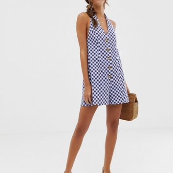 ASOS DESIGN halter romper with button detail in self stripe in gingham print | ASOS