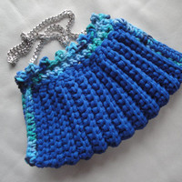 Handbag Handknitted Chic evening accessory Sky blue cotton yarn Pattern details Chain handle Magnetic stud closer Lined inside