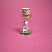 Tiny cherry blossom tree and a family in a tiny bottle B
