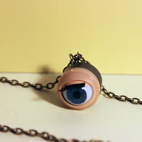 blinking doll-eye antique bronze necklace