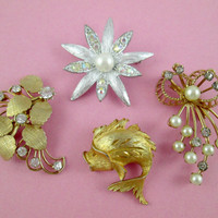 Delightful Brooches Lot of Four Silver Tone Starburst and Faux Pearl Pins Are Emmons Fish Pin is JJ and the Leafy Rhinestone Pin Unsigned