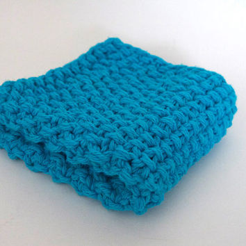 hand knit plushy cotton washcloth in bright aqua blue