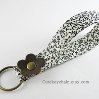 Fabric Key Chain, Fabric Wristlet Key Fob, Fabric Keyring, Keychain Wristlet, Black and White Floral Fabric With Brown Leather Flower