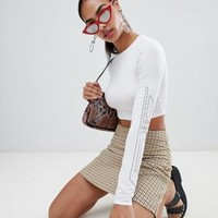 PrettyLittleThing Printed Long Sleeve Crop Top at asos.com