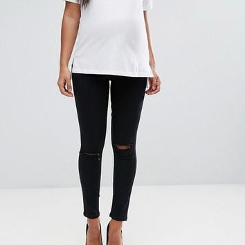 ASOS MATERNITY RIDLEY Skinny Jeans In Clean Black With Ripped Knees With Over The Bump Waistband at asos.com