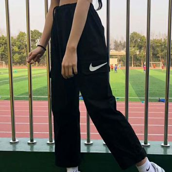 NKE 2018 sports straight overalls couple pocket print denim trousers F-XMCP-YC black