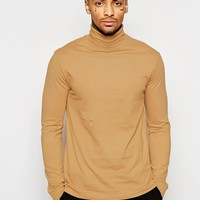 ASOS Long Sleeve T-Shirt With Roll Neck In Camel at asos.com