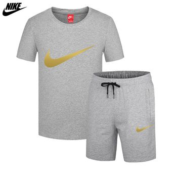 NIKE trend men's thin section sports breathable casual short-sleeved shorts running two-piece Grey