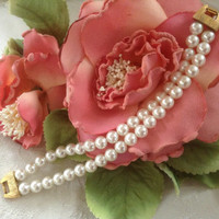 Napier pearl bracelet faux while pearls two strands patent pending goldtone clasp bow clasp brushed gold bridal vintage