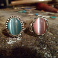Authentic Navajo Native American Southwestern sterling silver pink and blue fiber optic cat's eye rings. Sizes can be adjusted.