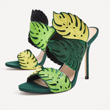 WRAP-AROUND LEATHER LEAF SANDALS DETAILS