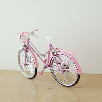 Retro girl's pink bucycle with a front basket, metal pink bike, collectible  miniature