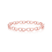 Tiffany & Co. - Tiffany Infinity narrow bangle in RUBEDO® metal, medium.