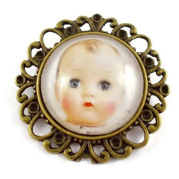 Doll head brooch, baby doll head cameo brooch, doll head jewellery, bronze brooch, round cameo, alternative brooch, creepy brooch