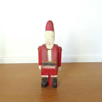 Wolf Creek carved wood folk art Santa Claus with articulating arms, signed by artist