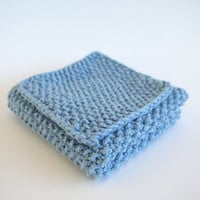 hand knit light blue cotton washcloth and bath scrubber set