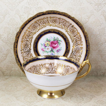 Vintage Paragon Gold Gilt Navy Blue and Pale Peach Floral Tea Cup and Saucer