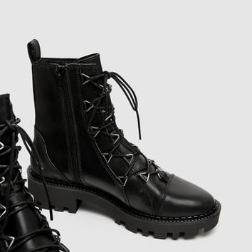 LEATHER BIKER ANKLE BOOTS WITH METAL DETAILS