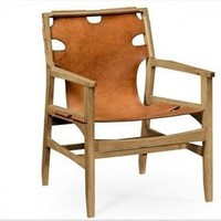 Midcentury style slung leather easy chair
