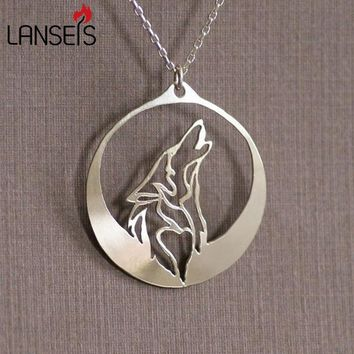 Moon Necklaces wolf howls into the night as its profile silver moon jewelry