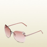 medium butterfly frame sunglasses with  small filigree butterfly on lens and gucci logo on temples. 298612I33301241