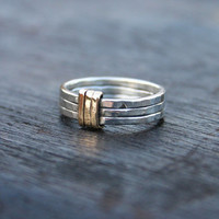 Sterling silver and 14K solid gold mixed metal band ring. Handmade, hammered, modern unique wide band ring with 14K solid gold detail.