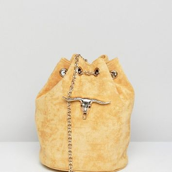 Sacred Hawk Faux Suede Shoulder Bag With Ram Head at asos.com