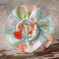 Spring Fling teal & tangerine ruffle and rosette on your choice of headband, alligator clip, or barrette