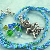 Sheela-na-gig fertility necklace - Leaves on River - blue, green, and lilac