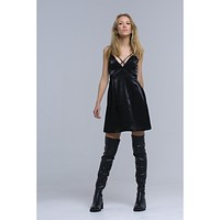 Black dress with crossed ribbons