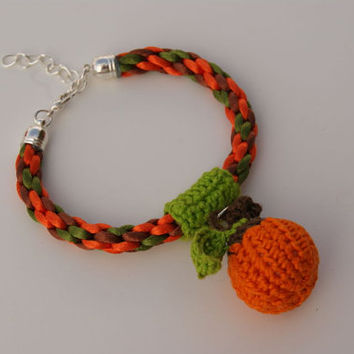 Pumpkin Colour, Brown and Green Braided Kumihimo Bracelet. Bangle with Crocheted Little Pumpkin Central Motif. Christmas Bracelet.