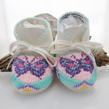 Native American Beaded Baby Moccasins and Soft Soled Shoes made of soft white deer hide.