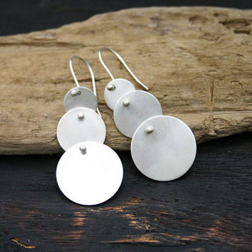 Sterling silver disc dangle earrings. Three multi disc earring, satin, brushed finish. Handmade, modern, contemporary, unique jewelry.