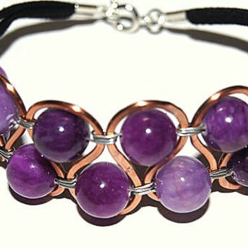 Copper swirl purple bead bracelet