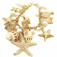 Basket Hill Watches and Gifts, Gold Tone Sea Shell and Pearl Charm Bracelet