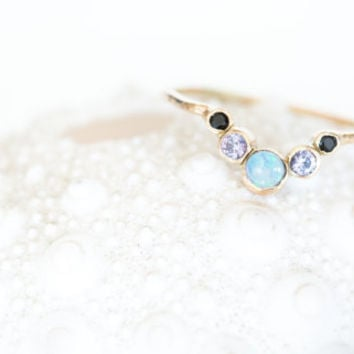 Esther ring. Opals, Alexandrite, and black spinel set in solid 14k yellow gold
